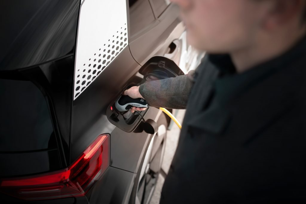A man putting fuel in his car