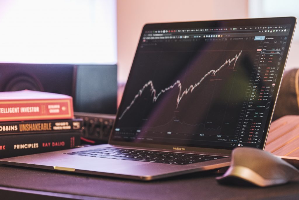 Laptop screen showing stock market charts